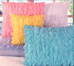 Pastel colors for a girls room...  I am so getting some of of these pillows for my 5 and 15 year old daughters!!!