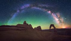 The Milky Way over #archesnationalpark in Utah. This is a panorama showing about 180 degrees of the night sky.