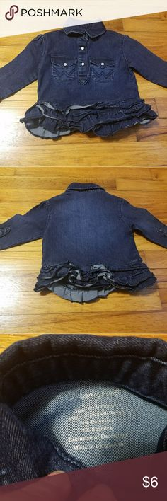 Wrangler denim top/onesie Wrangler denim top/onesie sized 6-9 month. Has snaps at crotch and cute ruffle detail that covers them.  Never worn. I washed it and hung it in the closet where it was forgotten. Wrangler One Pieces