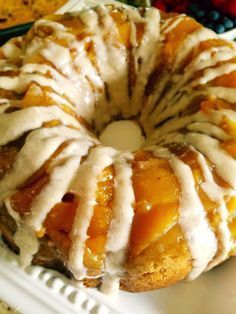 Peach upside down cake is studded with cream cheese bits and a cinnamon cream cheese frosting.