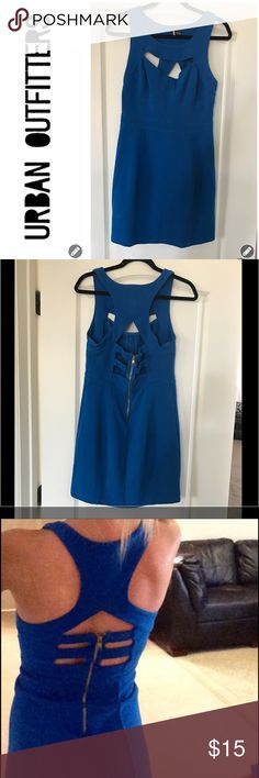 "Urban Outfitters Peek a Boo/ Body Con Dress Urban Outfitters Peek a Boo/ Body Con Dress is in Good Used Condition. This Dress is super Sexy and form fitting. It is featured in electric blue. The front features a Peek a Boo opening above a fitted bustier designed bodice. The back Features a sexy cut in Racerback enhanced with 3 Peek a Boo compartments. This dress is finished off with a gold zipper. Length from shoulder to hem 32"". Sparkle & Fade is a Urban Outfitters label. Great Dress. Smoke…"