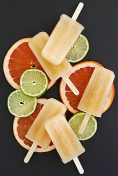 Paloma Popsicles | Girl Versus Dough  1/2 cup granulated sugar 1/2 cup water 2 1/2 cups grapefruit juice (from about 4 large grapefruit, if using fresh-squeezed juice) 1/2 cup lime juice 1/3 cup tequila Pinch sea salt  Jamie made as is with TJ's grapefruit juice because it's sweeter. Were awesome, but could handle being more tart so maybe skip some or all sugar and use TJ's grapefruit juice?