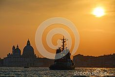 A beautiful sunset in Venice with ferry-boats sailing, photo taken from St. Mark& x27;s square, Italy, Europe.