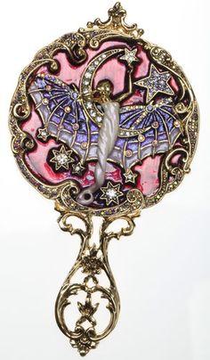Kirks Folly winged Goddess mirror.