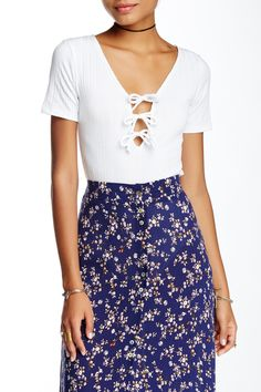 Boho vibes in this OOBERSWANK Lace-Up Short Sleeve Bodysuit.