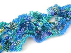 This freeform beaded cuff bracelet was made with wonderful blue colors and shades. Irregular, wavy, eventful, yet unified and harmonic jewelry. The texture