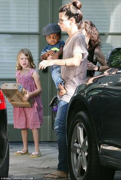 6ff190c2c420 Hats off to Sandra Bullock and son Louis with their co-ordinated headwear