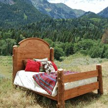 This Alder & Aspen Log Bed has a hand-carved Mountain Scene headboard.  Other designs are available - visit us at www.LogCabinRustics.com