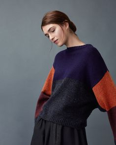 Kimono sleeved pullover in a colour blocked, heathery, traditionally spun lambswool. Ribbed round neck. Dropped shoulders. Ribbed cuffs and hem.
