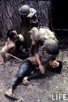 American soldiers interrogate Viet Cong soldiers in South Vietnam, ca. 1962-71    Ph. credit Larry Burrows