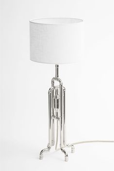 Urban loft table lamp in jellyfish, retro-futuristic shape. Here shown in modern nickel metal finish, with natural white linen shade and vintage ivory braided cord.