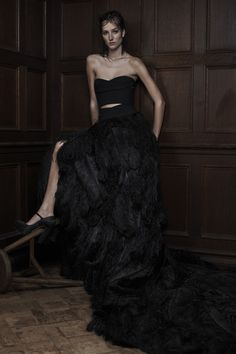 Black strapless sweetheart silk crepe and ostrich plume A-line gown with exposed midriff.