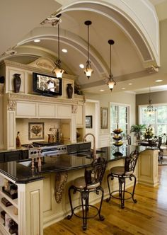 Love the arched ceiling gives it such an open feel. Would do white ceiling + cabinets though and dark floor.