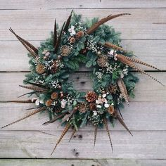 Large wild garden style wreath with pheasant feathers, pine cones, allium, nigella and teasle dried seed heads Christmas Door Wreaths, Christmas Flowers, Holiday Wreaths, Rustic Christmas, Christmas Crafts, Feather Wreath, Antler Wreath, Feather Crafts, Feather Art