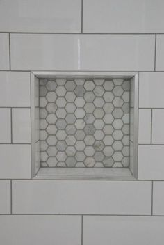 Looking to upgrade your bathroom shower? See how we used elongated white subway tile with dark gray grout and marble hex tile niche. Looks super luxe but on a budget! Click through for all the details. White tile with dark gray grout vs white grout Hall Bathroom, Upstairs Bathrooms, Bathroom Renos, Bathroom Flooring, Bathroom Ideas, Master Bathroom, Budget Bathroom, 1930s Bathroom, Bathroom Pictures