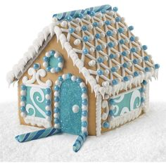 Celebrate this special time of year as you decorate a gingerbread Hanukkah house. This kit includes the colors of the holiday in fondant, candy and sugar to make decorating a Hanukkah gingerbread house a fun family activity! Gingerbread House Pictures, Cool Gingerbread Houses, Gingerbread House Designs, Gingerbread Village, Christmas Gingerbread House, Gingerbread Cookies, Diy Hanukkah, Hanukkah Decorations, Happy Hannukah