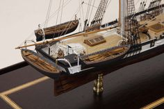 """Washington By: Bernd Braatz  This model depicts one of the original Revenue Cutters commissioned for the U.S. Navy in Baltimore, circa 1837. She was first built as a 91' topsail schooner of 190 tons, but re-rigged as a brig in 1838. She participated in the Seminole Wars in Florida on blockade duty.  Scale: 3/32"""" = 1' Size: 17 5/8"""" x 7 7/8"""" x 12 3/4"""""""