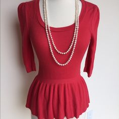 """Coral Peplum Sweater Adorable coral colored sweater with peplum waist. Half-sleeves, with a scoop neck. Super soft and comfy! Worn a few times, still in great condition. 25"""" long, 17.5"""" chest, 12"""" waist. 76% rayon, 24% nylon. Mossimo Tops Blouses"""
