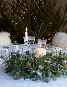 Christmas flower arrangements - simple rustic DIY ideas to try - From Britain wi., Christmas flower arrangements - simple rustic DIY ideas to try - From Britain with Love love this greenery and pine cone nordic christmas flower arran. Christmas Flower Arrangements, Flower Arrangements Simple, Christmas Table Centerpieces, Christmas Flowers, Christmas Table Settings, Christmas Wood, Christmas Wreaths, Christmas Tables, Christmas Flower Decorations