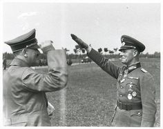 Master and Commander. Battlefield genius Erwin Rommel greets Der Fürher, Adolf Hitler. A jovial meeting. Things must be going 'wunderbar' at the front.