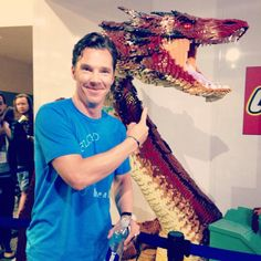 July 26, 2014 ~ Benedict Cumberbatch posing with a Lego version of Smaug at San Diego Comic Con's THE HOBBIT: THE BATTLE OF THE FIVE ARMIES panel.