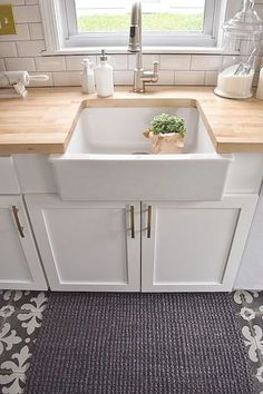 Kitchen Remodel - Nesting With Grace White Kitchen remodel with patterned tile and butcher block counter tops.White Kitchen remodel with patterned tile and butcher block counter tops. Kitchen Inspirations, New Kitchen, White Kitchen Remodeling, White Kitchen, Home Kitchens, Ikea Farm Sink, Kitchen Design, Kitchen Remodel, Stylish Kitchen