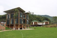 Image 1 of 33 from gallery of Energy Efficient Bamboo House  / Studio Cardenas Conscious Design. Photograph by LIB – Longquan International Bamboo Commune