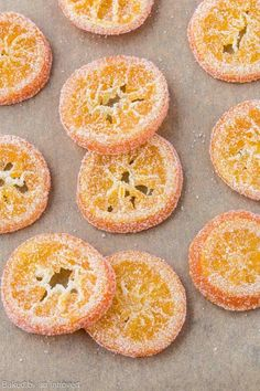 With this simple recipe, you can enjoy the Candied Orange Slices dipped in chocolate or use them to decorate your favorite dessert. #bakedbyanintrovertrecipes #orange #candy
