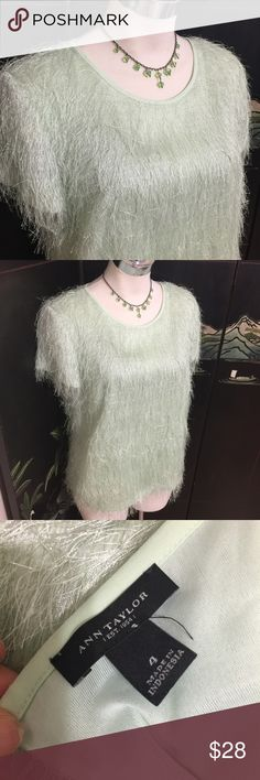 ANN TAYLOR MINT Green Shimmery Fuzzy Top Blouse M Label-Ann Taylor  Style- Dressy Shimmery Classic Short Sleeve Tshirt Blouse Top, in a shimmery sparkly fuzzy fabric. Hard to explain, see tag pic for best idea. Keyhole Opening, gold button closure. Boxy Shape, Bust darts.  Size-Label says 4. Shown on a 2.  Runs Big. I think it was missized. I think would fit M 8 best.  Measurements-B-38, Hip- 40, Length from underarm seam to hem-13? Color-Palest MINT Green, Looks amazing with Grays or White…