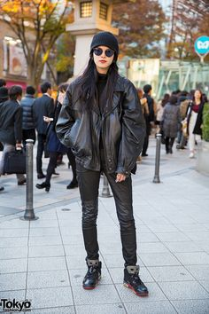 Model Miho Shida on the street in Harajuku wearing a black leather jacket with leather pants and Nike Air Jordan sneakers.