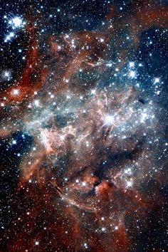 NGC 2060 - NGC 2060 is a star cluster within the Tarantula Nebula in the Large Magellanic Cloud, very close to the larger NGC 2070 cluster containing R136. It was discovered by John Herschel in 1836. It is a loose cluster approximately 10 million years old, within one of the Tarantula Nebula's superbubbles formed by the combined stellar winds of the cluster or by old supernovae.