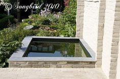 turning a garden shed into a pond, concrete masonry, outdoor living, ponds water features, Concrete pond that is like a mirror