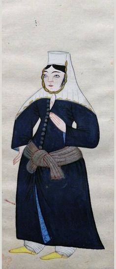 """56v An Armenian woman who wears a dark blue outer robe with pale blue lining, silver and red girdle, white trousers, yellow shoes, white round hat with an attached cloth that covers her shoulders.  Peter Mundy's Album, """"A briefe relation of the Turckes, their kings, Emperors, or Grandsigneurs, their conquests, religion, customes, habbits, etc""""  Istanbul 1618"""