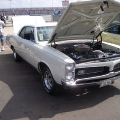 1967 Pontiac GTO  Still not mine but had one once in a previous life.  Just like this...always had the hood up, tuning that 6 pack.
