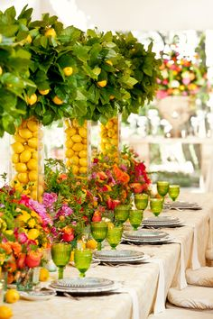 Fun and festive bright floral centerpieces featuring lemons