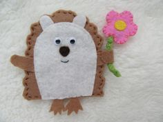 This cute hedgehog brooch would make a great wildlife lovers gift, or nature lovers gift. Each hedgehog badge is hand cut and stitched by me from brown acrylic felt, with a cream body, and cute googly eyes to add lots of character. Each cute hedgehog i. Cute Hedgehog, Googly Eyes, Gifts For Nature Lovers, Felt Flowers, Gift For Lover, Badge, Wildlife, Handmade Items, Brooch