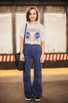 Subway Stalking: Spring Edition! #refinery29  http://www.refinery29.com/nyc-subway-street-style-pictures#slide-8  Name: Isabelle Barbier Job: Actor What She's Wearing: Vintage top and jeans, Vans sneakers.Spotted On: The L trainA thrifted Super Bowl tee and flared, high-waisted jeans make for a laid-back (but still very on-trend) look.