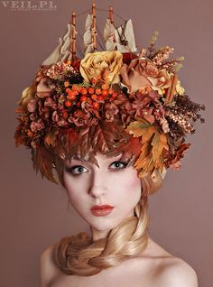 One of a kind, handmade headdress decorated with autumn leaves, flowers and fruits. Center part of the crown is a wooden ship. Each element is