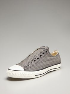 Converse Canvas Vintage Slip-On Sneakers    Classic. Easily casual paired with jeans, but try a solid color button-down and blazer. Please still keep the look fitted, never bulky.