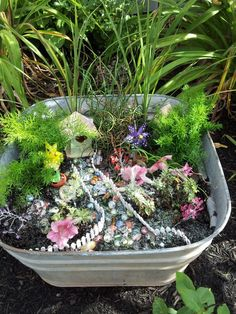 Fairy Garden... One corner, USe rocks to maze around pathway add more houses and more fairies. Small flowers in different colours