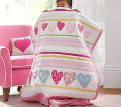 Heart Quilted Bedding // This heart patchwork quilt is made of a mix of colorful fabric patterns with embroidery details.