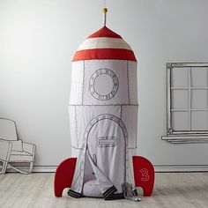 Oh my gosh! Land of Nod's To the Moon Play Home Canopy.  So adorable!  And I am so digging those paper cut-outs too! $229