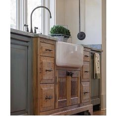 I surprisingly like the combination of an upcycled unit used alongside standard cupboards! Unique look