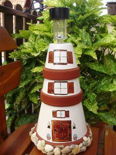 DIY lighthouse flower pots + paint + garden light and some shells Flower Pot Art, Clay Flower Pots, Flower Pot Crafts, Flower Pot People, Clay Pot People, Clay Pot Projects, Clay Pot Crafts, Painted Clay Pots, Painted Flower Pots