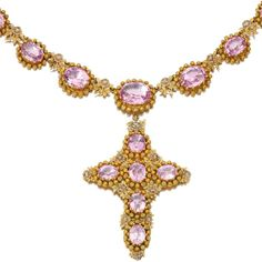 Gold And Topaz Necklace Designed As A Series Of Graduated Oval Pink Topaz Within Fine Canetille Work Borders, Suspending A Pendant Of Cruciform Design   c. Early 19th Century