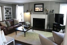 Small Living Room, Contemporary On A Budget Small Living Room Décor With Light Grey Walls And A Dark Brown Rectangle Mirror Over White Mantel Fireplace With Brow Leather Sofa And Glass Table With White Fur Rug And White Sofa: Mesmerizing Yet On A Budget Small Living Room Decor
