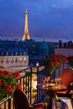Hotel San Regis ~ Paris.  Stayed with the kids July 2012.  Rooms are huge by Paris standards and they do have connecting rooms - very hard to find there.  Only a few rooms have a view of the Eifel Tower.