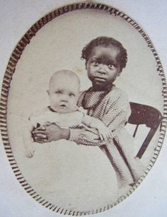 """""""Portrait unidentified at link, but presumably the very young black child holding the white baby was a slave assigned to mind the white family's child"""". Vintage Children Photos, Vintage Pictures, Old Pictures, Vintage Images, Old Photos, Antique Photos, Vintage Photographs, Afro, Post Mortem Photography"""