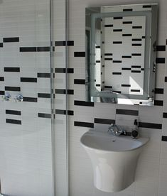 Metro tiles remain a key element in creating a vintage-inspired monochromatic bathroom. Using black metro tiles to create patterns within the larger field of white is an excellent way to bring your own personal style into the design of your bathroom and create interest within the space. #metrotiles #monochromaticbathrooms #vintageromance #featurewall #tiles #bathroomdecor #home #homedecor #trendingdesign