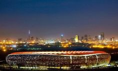 The stunningly dramatic FNB Stadium in Johannesburg, South Africa Soccer City, Soccer Stadium, Football Stadiums, The Places Youll Go, Places To Visit, Night City, Africa Travel, Countries Of The World, South Africa